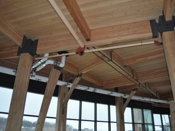 An inside look inside the space above the front lobby where Hooper plumbing installed much of the pipe work seen here. This photo was taken almost a year before project completion before everything was truly blended into the woodwork.