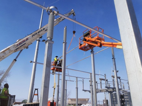 Crews installing and welding A-frames and high bus in the main 138 kV substation.