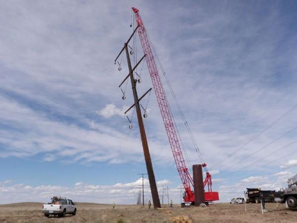 Crews working on steel poles