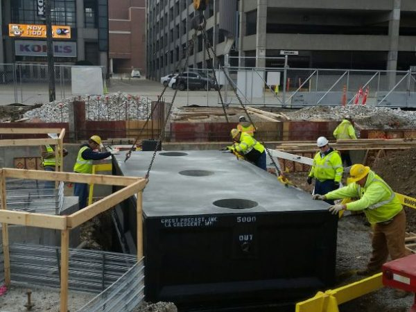 A crew works to install a grease interceptor.