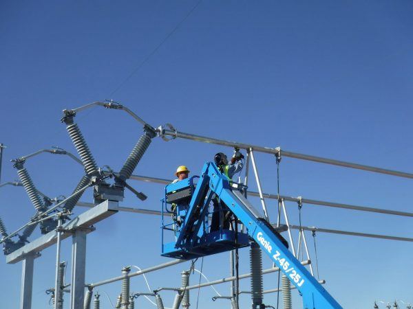 Hooper crews work on the final welding of the overhead bus support system.