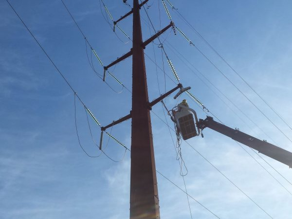 Crew grounds wire in preparation to install jumpers.